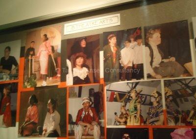 Стенд с фото театральных постановок в Dwight School